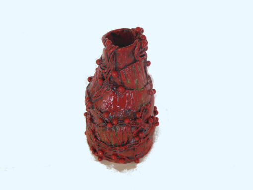 Red Bottle with strings and orbs top