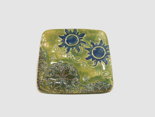 Square Tray Green with 2 blue suns by Nellie Ralat front